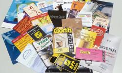 Fotos von Foldern die von der Otto Stutzig Werbeagentur erstellt wurden